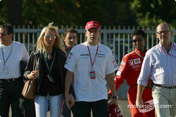 Olivier Panis arrives in the paddock with wife Anne