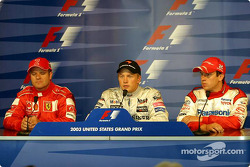 Press conference: pole winner Kimi Raikkonen with Rubens Barrichello and Olivier Panis