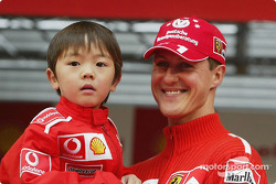 Michael Schumacher with a young fan at a Shell promotional event