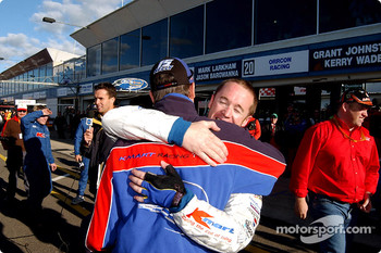 Greg Murphy is congratulated by team mate Rick Kelly after grabbing pole position