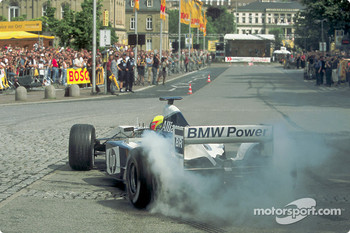Ralf Schumacher does a demonstration run in the city of Stuttgart