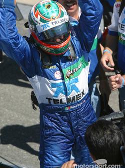 Race winner Memo Rojas celebrates