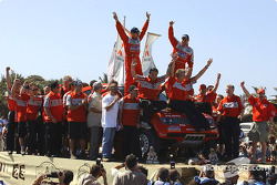 Overall winner Stéphane Peterhansel and Jean-Paul Cottret celebrate with Mitsubishi Motor Sports team members