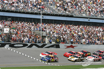 Green flag: Greg Biffle takes the lead ahead of Dale Earnhardt Jr.