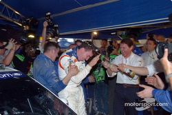 Winner Markko Martin celebrates in Ford service area