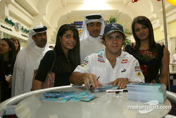 Felipe Massa signs autographs for his fans at the Seef Mall shopping centre in Manama
