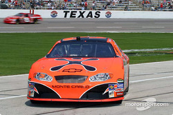 Robby Gordon pulls in as Dale Earnhardt Jr. streaks by