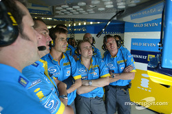 Renault F1 team members watch Jarno Trulli qualifying lap