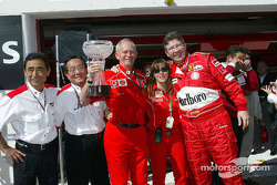 Rory Byrne and Ross Brawn celebrate victory