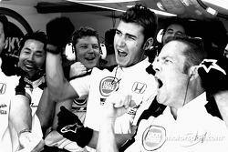 BAR-Honda team members celebrate as Jenson Button takes pole position