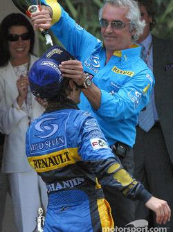 Flavio Briatore pours champagne on Jarno Trulli