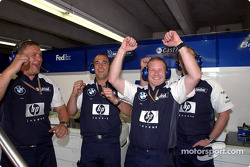 Williams-BMW team members celebrate Ralf Schumacher's pole position