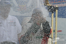LM P1 podium: champagne for Tom Kristensen