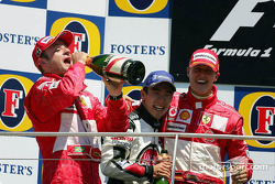 Podium: race winner Michael Schumacher with Rubens Barrichello and Takuma Sato