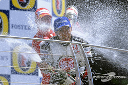 Podium: champagne for Takuma Sato