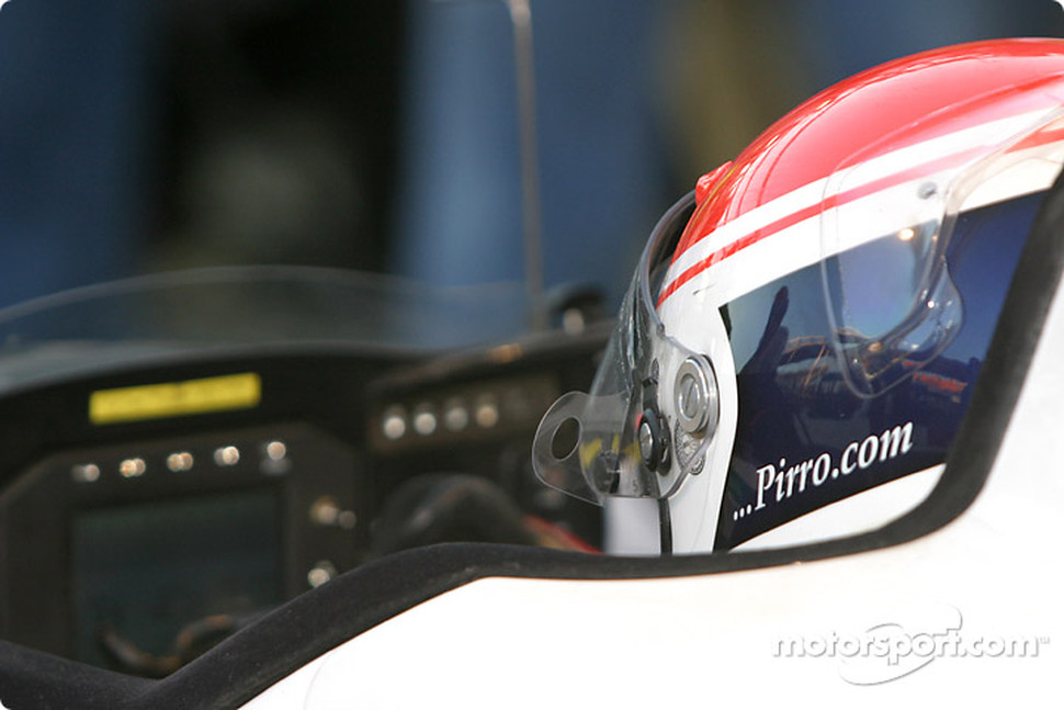 Emanuele Pirro waits in the car