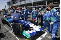 Sauber team members on the starting grid
