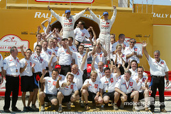 Podium: winners Sébastien Loeb and Daniel Elena celebrate with their team