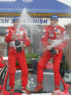 Podium: Marcus Gronholm and Timo Rautiainen celebrate win