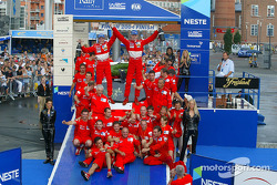 Podium: Marcus Gronholm and Timo Rautiainen celebrate win with Marlboro Peugeot Total team