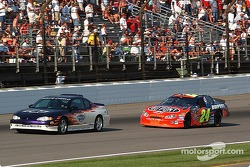 After a incident in turn 2 the pace car leads Jeff Gordon to the green flag with 2 laps left
