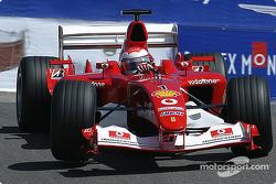 Ferrari test driver Andrea Bertolini drops into the corkscrew
