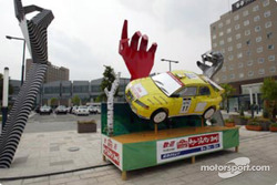 A car on display attracts the rally fans attention on one of Obihiro's squares