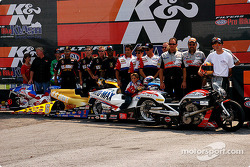 Shawn Gann, Antron Brown, Geno Scali, and Andrew Hines pose with their crews prior to the K&N Pro Bike Klash