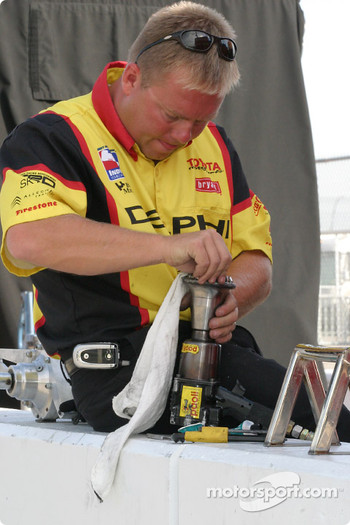 Crew member cleans up air gun