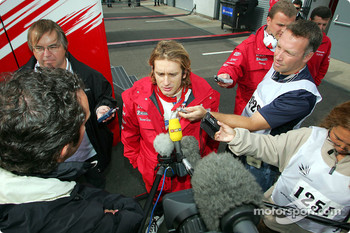 Jarno Trulli talks to media