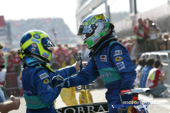 Felipe Massa and Giancarlo Fisichella celebrate point finishes