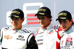 Esteban Gutierrez celebrates victory on the podium with Robert Wickens and Roberto Merhi