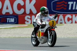 Giacomo Agostini rides his 1975 championship winning Yamaha OW23