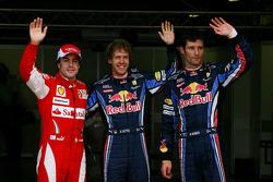 Pole winner Sebastian Vettel, Red Bull Racing, with second place Mark Webber, Red Bull Racing and third place Fernando Alonso, Scuderia Ferrari