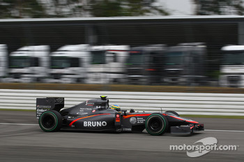 Bruno Senna, Hispania Racing F1 Team passing lorries that would normally be in the paddoc