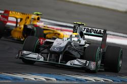 Nico Rosberg, Mercedes GP leads Vitaly Petrov, Renault F1 Team
