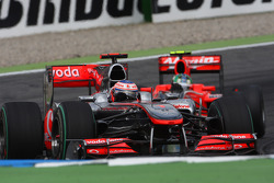 Jenson Button, McLaren Mercedes leads Lucas di Grassi, Virgin Racing