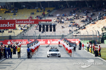 The safety car on the empty grid with the grid girls