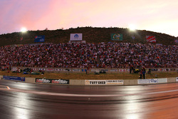 The sun sets behind the stands at the Bandimere Speedway, Morrison, Colorado