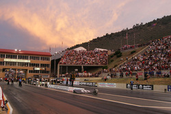 The sun sets behind the stands at the Bandimere Speedway, Denver, Colorado