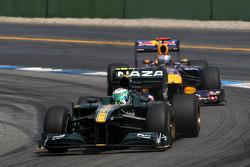 Heikki Kovalainen, Lotus F1 Team leads Sebastian Vettel, Red Bull Racing