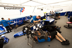 Mechanics work on the cars of Dean Smith, Josef Newgarden and Antonio Felix Da Costa in the garage
