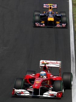 Fernando Alonso, Scuderia Ferrari leads Mark Webber, Red Bull Racing