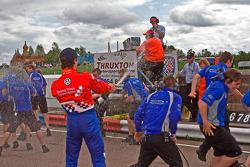 James Calado sprays his team members