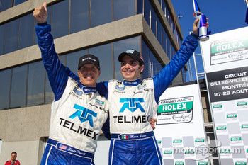 Race winners Scott Pruett and Memo Rojas celebrate