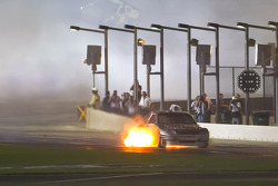 Scott Speed, Red Bull Racing Team Toyota on pit road after his engine catches on fire