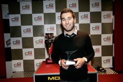 Daniel Morad receives his trophy