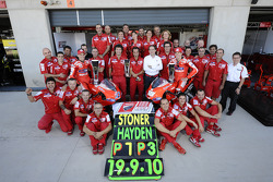Race winner Casey Stoner, Ducati Marlboro Team, celebrates with Nicky Hayden, Ducati Marlboro Team and Ducati team members