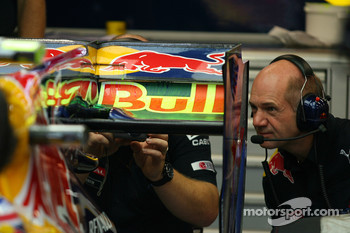 Adrian Newey, Red Bull Racing, Technical Operations Director looking at the back of the car