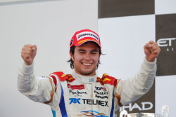 Sergio Perez celebrates his victory on the podium